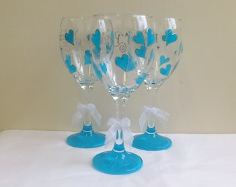 Personalised bridesmaid wine glass with a turquoise teal hearts and base hand painted by Luci Lu Designs