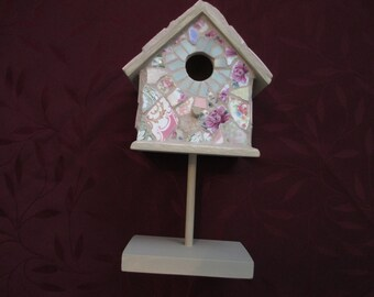 Shabby chic pastel rose pattern and vintage mosaic china bird house on a stick and wood base