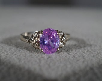 vintage sterling silver fashion ring with large oval faceted amethyst in a floral setting, size 9 1/2   M8