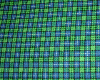 Crib sheet, Tartan in John Deere Green and royal blue.  Fits standard size crib 6 inch crib mattress.  Elastic around entire edge of sheet.