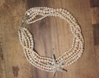 Beach Wedding Freshwater Pearl Five Strand Necklace with a Rhinestone Crystal Starfish Broach.