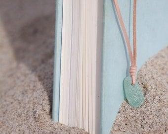 Aquamarine teardrop sea glass necklace on a leather