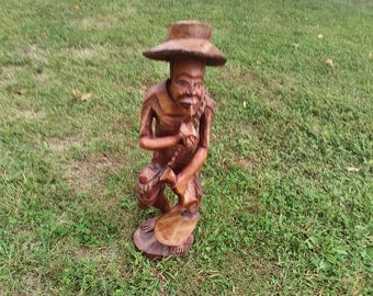 Man smoking pipe wood folk art statue