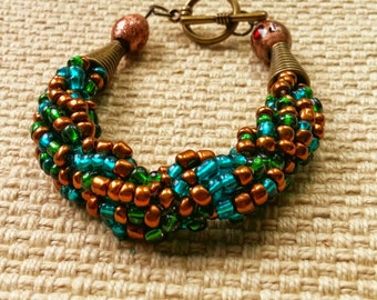 forest bronze bracelet (large): hand woven spiral rope of glass beads