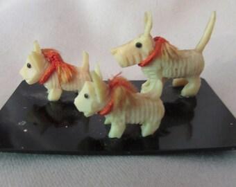 Miniature Scotty Dogs on Plastic Platform Japan
