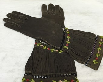 Vintage brown leather gloves marked Landel.  Floral embroidery.  Women's size 6.75.  Made in France.