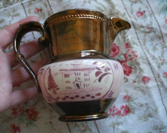 Antique Staffordshire lustre ware jug, pink folk art house