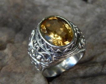 Silver ring boma carving motif with citrine stone