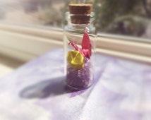 Purple glass wish bottle ( crane and star)