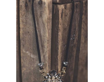 Gorgeous crystal pendant on black suede cord