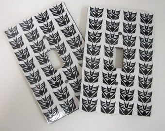 2 light switch plate covers, Transformer Deceptacon design