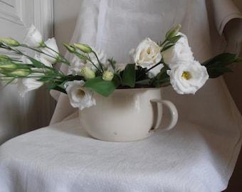 A white enamelware French vintage chamberpot