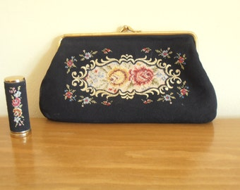 A vintage petit point/needlepoint/tapestry/needlework, crepe de chine purse with lipstick holder from the 1950s