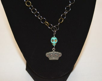 crown and turquoise skull necklace
