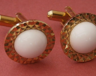 B61) A stylish pair of vintage gold tone metal and round domed white glass diamond cut cufflinks