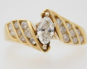 0.89 Carat T.W. Marquise & Round Cut Diamond Engagement Ring 14K Yellow Gold
