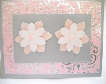 Beautiful, metallic pink and silver handmade card. Blank inside to write your own message.