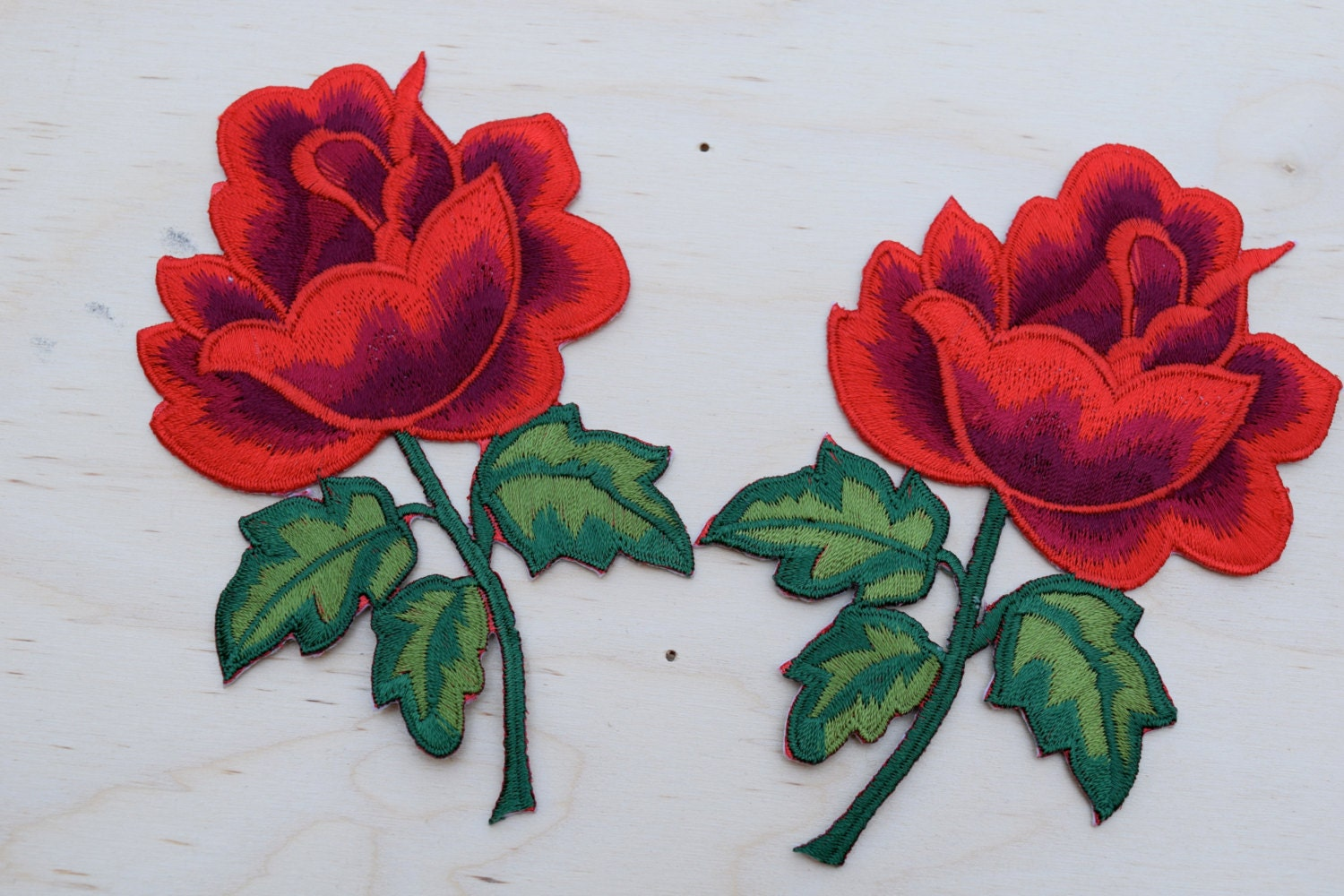 Red rose embroidery patches strickingly vibrant