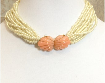 Peach, gold tone and pearl stranded necklace