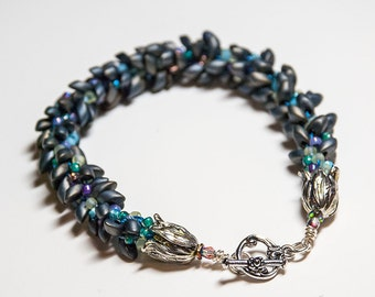 Kumihimo bracelet adorned with spirals of smokey magatama beads for any occasion