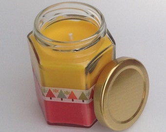 Handmade scented candle. Christmas scented candle in a hexagon jar