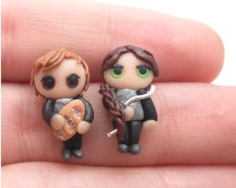 Handmade Katniss Everdeen and peeta Melark miniature earrings, made with polymer clay (all my jewelry is nickel free!)