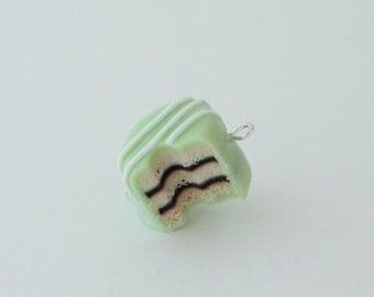 polymer clay, miniature,bitten petit four charm, mint green, kawaii food, circle shaped petit four