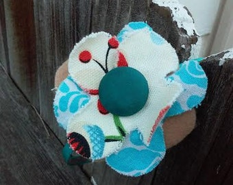 Floral Cloth Headband Accented With Blue Silky Vintage Button