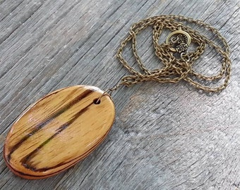 Handmade Zebra Wood Pendant Necklace-Exotic Wood-Oval-On Antiqued Brass Chain