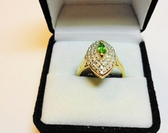 Tsavorite Garnet Ring.   Set in a 14kt. Gold Ring with Diamond Accents.