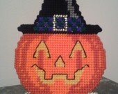 Finished plastic canvas halloween pumpkin.  Adorable decorative halloween pumpkin with witch hat, stands on his own