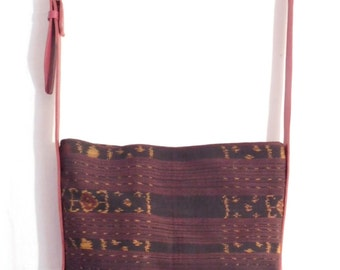 Handwoven ikat fabric and red leather cross body messenger bag