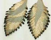 Two Gold and White Leather Feathers 005