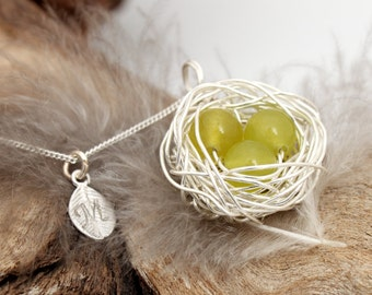 Personalized bird nest necklace with three peridot eggs and initial charm- silver plated woven wire- August birthstone- crystal healing