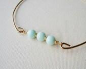 Aqua and Gold Beaded Gold Charm Bangle . Brass Stackable Bracelet  . Light Aqua Blue Glass Bead Charm Bracelet . Aqua Bracelet