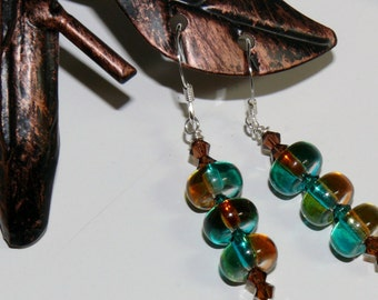 Ladies handmade dangle earrings with glass brown/teal disc and Swarovski bicone crystals with sterling silver earwires