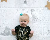 GOD is within her She will not fail - girls graphic gold foil onesie