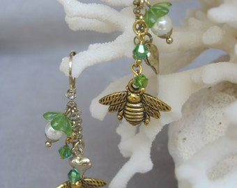 Buzzing Bees with Hearts and Flowers Accented by Green Crystals Dangling Earrings