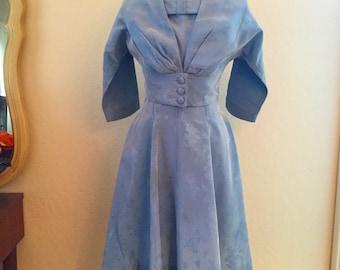 Blue vintage 1950s dress and jacket. Floral mad men retro mod outfit