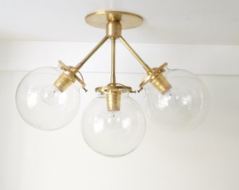 Rose • solid brass triple clear, smoked, or satin glass globe light • UL LISTED