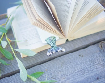Mermaid tale in the book .Unusual art bookmark.