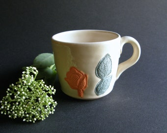Floral Coffee Cup with Raw Colored Porcelain Flower and Leaf Design on White Stoneware Glaze Lemon Yellow Grey Sherbet Teal Ceramic Mug