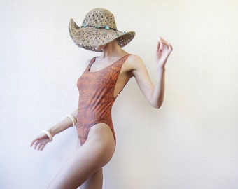 Orange black print low back high leg one piece swimsuit M-L