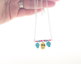 Yellow and Turquoise Skulls with Red Crystals Necklace