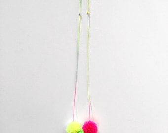 Neon pom pom necklace on pastel ombre cord
