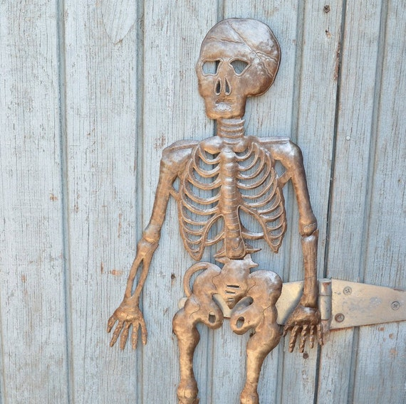 """Hanging Skeleton, Haitian Metal Art, Hand pounded made from a 55 gallon metal barrel 13"""" x 28"""""""