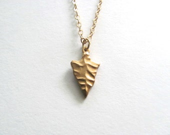 Tiny golden arrowhead pendant necklace on delicate 14k gold plated chain, tribal jewelry