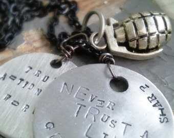 Never Trust a Live Grenade - silver stamped metalwork tag, metal charm & sealed black chain necklace