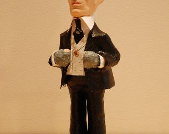 Karl Lagerfeld figure, paper mache sculpture, doll