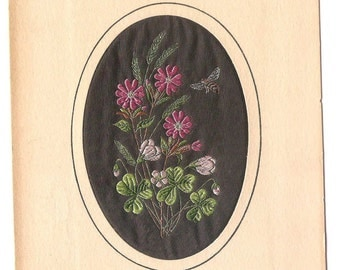 Embroidered  flower picture in oval border  (textile)